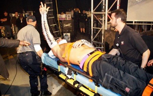 An injured Jeff is escorted from the ring on a stretcher.