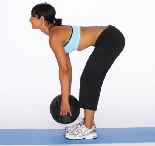 Start doing deadlifts with very very light weights for becoming habitual like this lady is doing it with a ball.