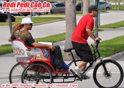 Redi Pedi pedicab driver assist convention attendees get to their cars at the end of the day at the Orange County Convention Center on International Drive in Orlando, Florida.