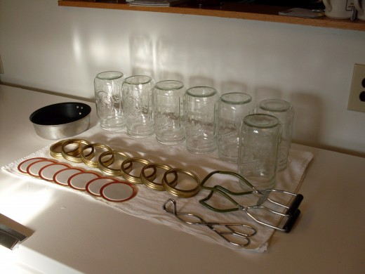 Check jars for nicks, cracks, and other problems. Wash in hot, soapy water. Scald if necessary. Wash lids and rings.