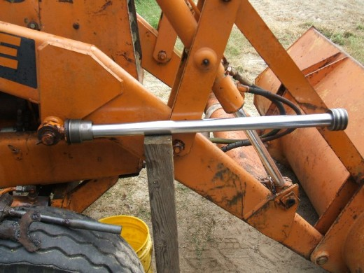 Wood post used as brace for tightening piston bolt
