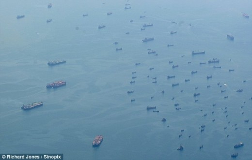 Richard Perry's Sinnopix photo of the ghost fleet of commercial container ships near Singapore