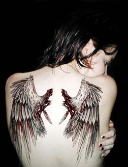 example of battle worn angel wings tattoos