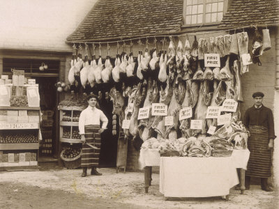 Old style butchers.  Shows rabbit and other game hanging for sale.  No 'elf 'n' safety back then, and we were better for it.    photo from allposters.com