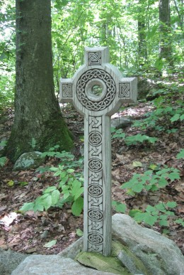 A Celtic cross over The Sacred Well