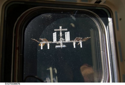 View of the International Space Station from a space shuttle aft flight deck window.
