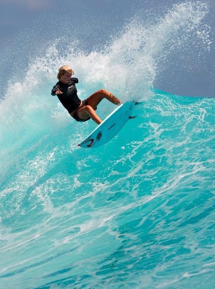 Bethany Hamilton-13 yr old girl who lost her arm to a shark attack return to the waves less than a month after the accident.