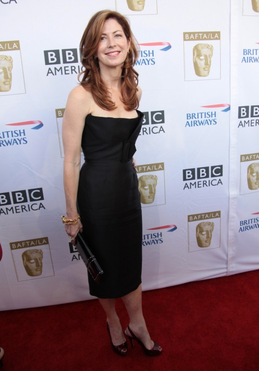Dana Delany in a black strapless dress