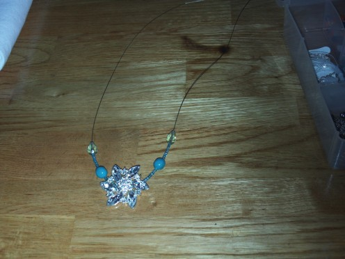Add a light blue crystal bead to each side of the chain.