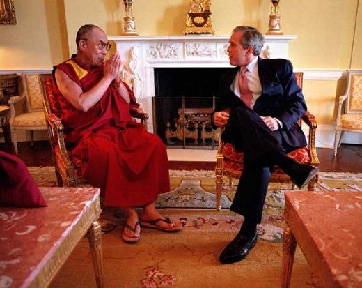 President Bush presents the Congressional Gold Medal to the Dalai Lama.