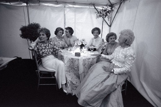 First Ladies Nancy Reagan, Ladybird Johnson, Hillary Rodham Clinton, Rosalyn Carter, Betty Ford, and Barbara Bush sit together at the National Garden Gala, 1994.