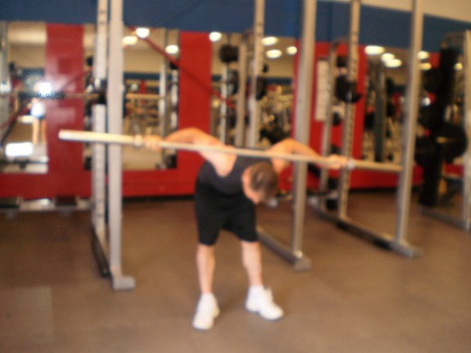The Barbell Good Morning down position.