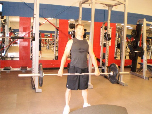 The Barbell Stiff legged deadlift up position