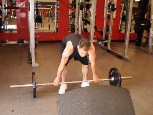 The Stiff Legged Barbell Row start position.