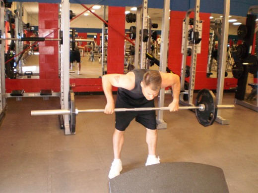 The Stiff Legged Barbell Row up position.