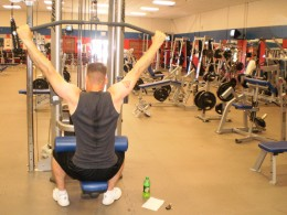 The Seated Lat Pulldown start position