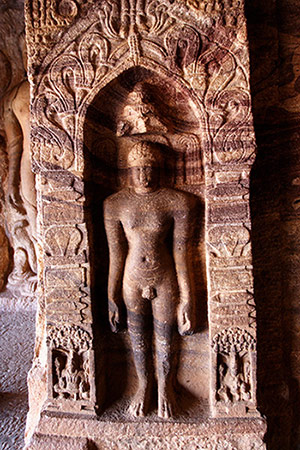 Statue of a jain Tirthankara, carved at the bottom of a piller