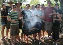 Friends having fun in the sun with beer and braaivleis