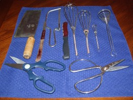 Back L to R; meat cleaver,citrus blade hacksaw,bagel knife, whisks; foreground L to R regular and heavy duty scissors