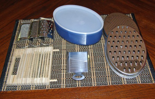 Top L to R; hand graters, bowl grater, bamboo grater, nutmeg grater