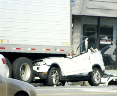 A white BMW SUV ran into the back of a tractor trailer. The entire front of the car was trapped under the truck. http://www.baristanet.com/2009/04/car_accident_near_caldwell_col.php