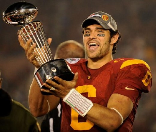 USC quarterback Marc Sanchez holding the Rose Bowl trophy.