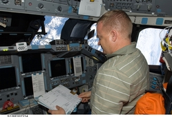 Eric Boe on the flight deck docking with the ISS.