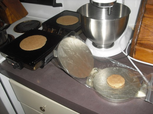 pressing and cooking the tortillas