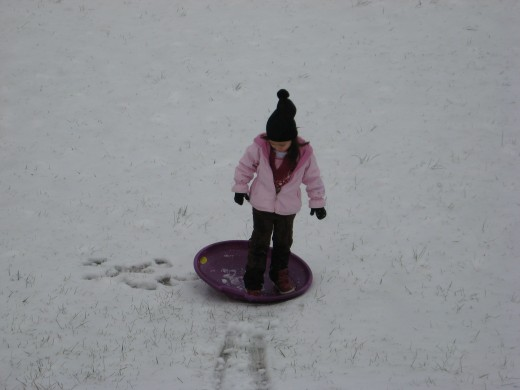 Lexi with the snow saucer