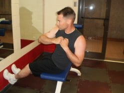 The Roman Chair with Russian Twist up position