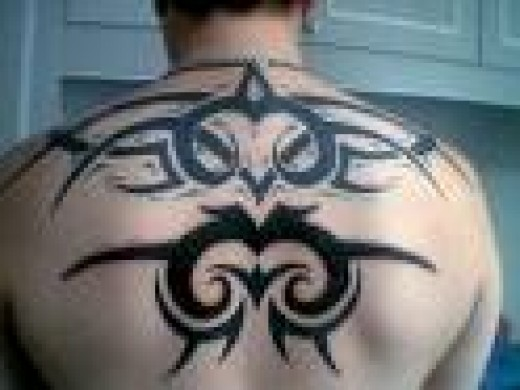 tribal tattoos on back. tribal lower ack tattoo