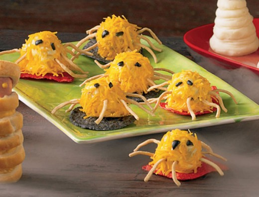 "Meatball Spiders with shredded cheese ""hair"" and dried Chinese noodle legs"