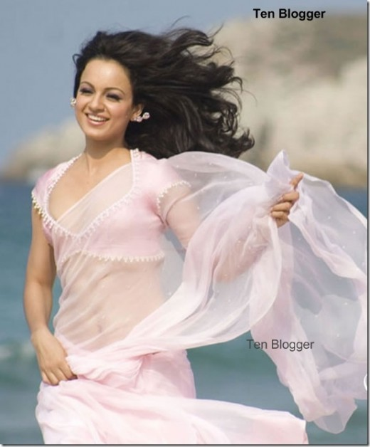 kangna ranaut is gracefully flying in clouds in light Saree. Way to go Kangana.