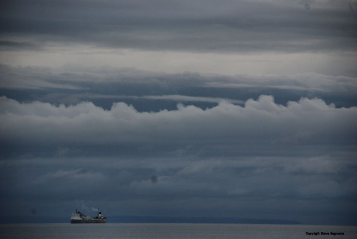 A laker sits anchored in Whitefish Bay Monday, Sept. 28, waiting for a storm to arrive and pass before heading around Whitefish Point into the open waters of Lake Superior.