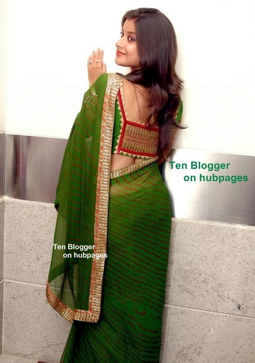 Madhurima - nice hair - showing off cool green saree