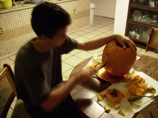 Creating a Jack O Lantern Step 3 - Using a sharp knife, begin to cut out the areas you had marked for the face