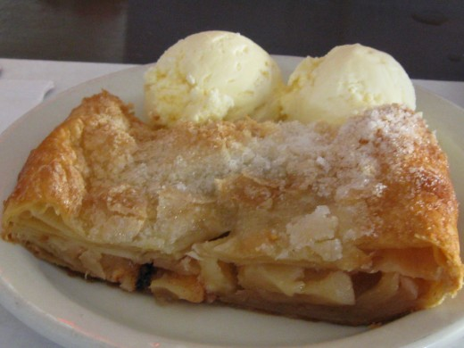 Plain apple strudel served with vanilla ice cream