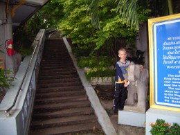 On the stairs to the temple in Bangkok. Around 92% of residents are Buddhists.