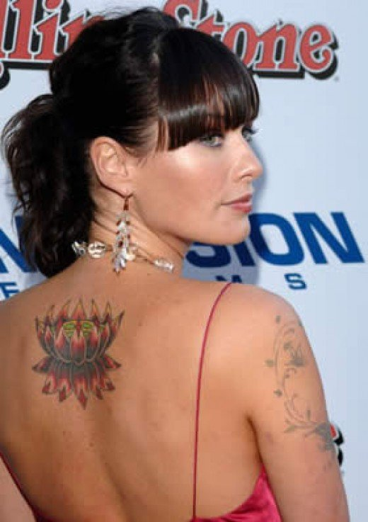 Britney Spears and Lindsay Lohan, Sienna also has star tattoos.