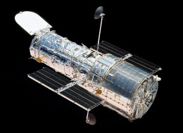 Courtesy of NASA/ Atlantis bids Hubble a last farewell.
