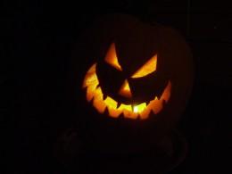 Scary Jack-O-Lantern glowing in the dark
