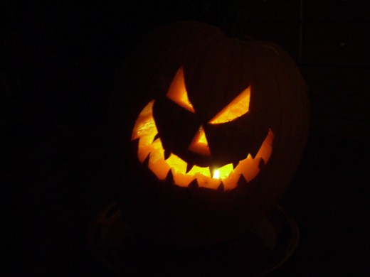Scary Jack-O-Lantern glowing in the dark