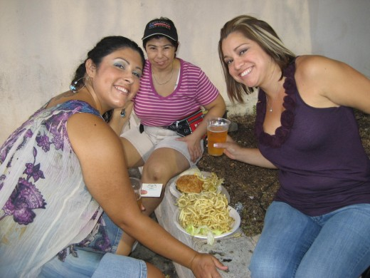 fair goers eating, enjoy girls