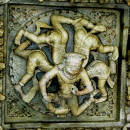 A man with is 5 senses.Exquisite carving on a ceiling.