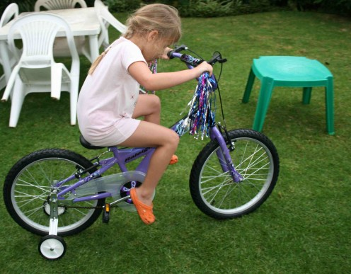 "Caitlin the day she got her bike. Her bike is a Raleigh ""Jazzi"", by the way."