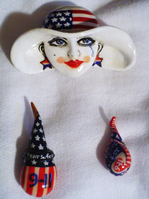 Lady Liberty weeps for the masses lost and tears for 9/11  drape the fabric of our society.