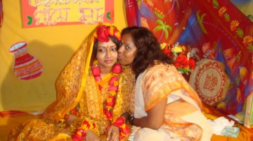 "A Bengali Bride on the day of the ""Gaiyer Holud,"" after the turmeric has been rubbed on her."