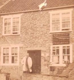 Harry Beacham outside the village post office at Buckland Dinham C1930
