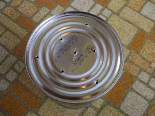 Make a few drainage holes in your recycled cans so plants do not get soggy