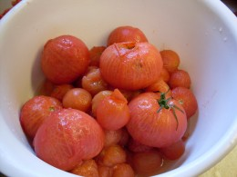 A bowl of just-blanched, skinned tomatoes.